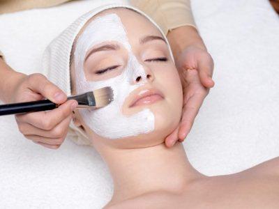 12084638 - beautiful young woman having a facial cosmetic mask at spa salon