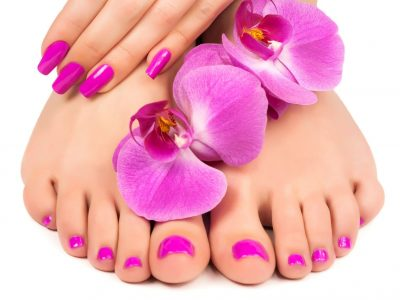 18875326 - pink manicure and pedicure with a orchid flower