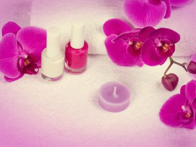 Salon for manicure. Nail polish for french manicure decorated with flower