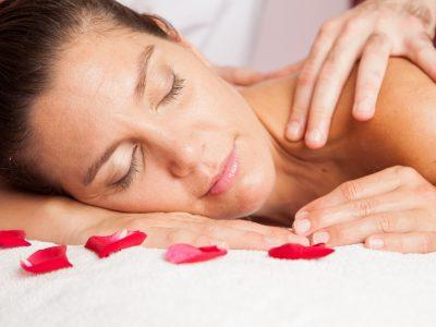 woman-receibing-a-massage-at-the-spa_rwuxG2hv2Me